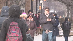 Busy streets people traffic congestion in downtown Toronto on winter day. - stock footage