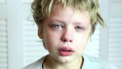 Portrait of little boy crying. eyes full of tears. close up of children face Stock Footage