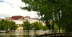 4k Potala reflection on lake in Lhasa park,Tibet.lake with willow. Stock Footage