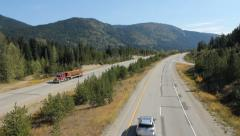 Coquihalla Hwy between Hope and Merritt, BC, Canada. Truck and traffic passing. - stock footage
