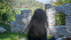 Couple joins the children on the castle ruins Stock Footage