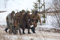 transport the machine gun maxim - stock photo