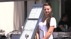 WAITRESS OUTSIDE FRENCH CAFE Stock Footage