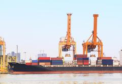 Industry container ship on port for import export Stock Photos