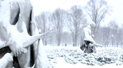 Snow Falling on Korean Memorial Soldiers Tight Rifle.mp4 - stock footage