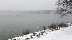 Snow Falling on Potomac River and Memorial Bridge.mp4 Stock Footage