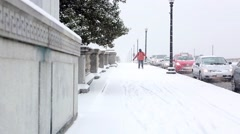 Traffic and Man Walking in Snow on Arlington Memorial Bridge.mp4 - stock footage