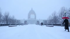 US Capitol in the Snow Woman with Red Umbrella.mp4 Stock Footage