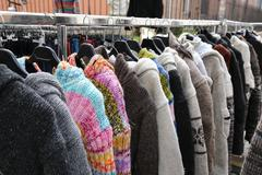 Sweaters and vintage clothes for sale at the  flea market Stock Photos