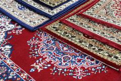 Carpets decorated in an islamic mosque Stock Photos