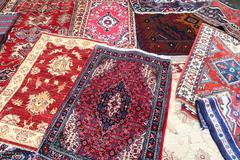 Colored carpets decorated in an islamic mosque Stock Photos