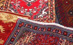 Colored carpets decorated in an islamic house Stock Photos