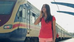 Young Woman Traveler Waiting With Anxiety Makes Phone Call On Train Station HD Stock Footage