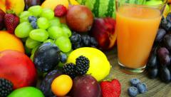 fresh juice and a bunch of fruit - stock footage