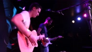 Stock Video Footage of Rock Concert: Musicians on the stage (angle in profile)