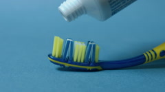 Tooth brush and paste Stock Footage