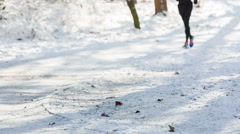Runner in park in winter with snow Arkistovideo