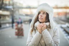 Young woman feeling cold in winter day Stock Photos