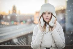 Russian woman in the winter city - stock photo