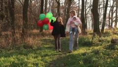Family Time A Mother With Her Daughters, Baby And Little Girl, Walking In A Wood - stock footage