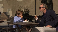 Father and son eating ice cream in Stockholm Stock Footage
