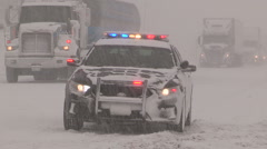 Snowstorm and severe blizzard with car accidents and crash scenes - stock footage