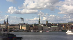 Ferries approaching the pier in Stockholm Stock Footage
