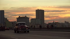 Stock Video Footage of Cuba La Habana Havana Malecon At Sunset With People And Old Cars 4K