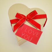 heart-shaped gift box and signboard with the text i love you, with a retro ef - stock photo