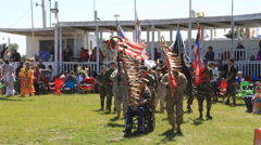 Native military veterans lead a grand entry Stock Footage