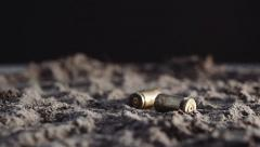 9mm bullet shells falling in slow motion Stock Footage
