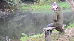 Woman portrait sit on bench in morning of winter season at forest Stock Footage
