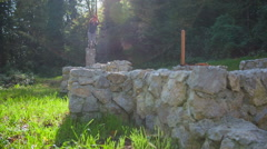 Young man free running through the castle ruins Stock Footage