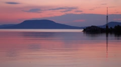 Twilight on balaton lake with badacsony and soft water ripples Stock Footage
