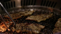Asian BBQ Grilling pork and veal meat on a gas grill in restaurant chinese-Dan Stock Footage