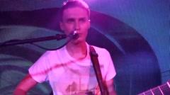 rock concert: medium shot on a rock band vocalist (camera on Steadycam) - stock footage