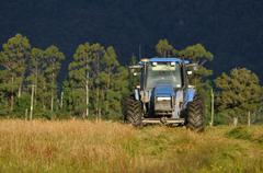 mowing pasture - stock photo