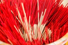 red  incense in a buddhist temple - stock photo