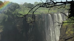 Victoria falls waterfalls with rainbow in background Stock Footage