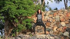 Beautiful girl doing shamanic dance in nature Stock Footage