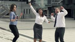 Happy businesspeople dancing in the city, slow motion shot at 240fps HD Stock Footage