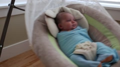 A newborn baby boy in a swing Stock Footage