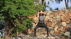 Beautiful girl doing shamanic dance in nature. Stock Footage