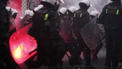 Police squad during riots Stock Footage