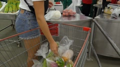 Woman at Supermarket with Shopping Trolley with Vegetables Stock Footage
