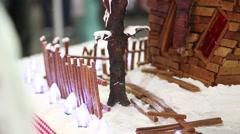 Gingerbread house santa on roof tilt Stock Footage