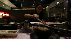 Beautiful woman asiatic doing BBQ Grilling meat in restaurant chinese-Dan Stock Footage