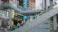 People on escalator at the shopping mall in Pudong District, China, BlackMagic - stock footage