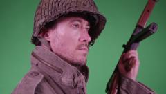 4K Soldier walks in front of green screen - stock footage
