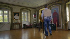 Couple walks in the room of the historic person Stock Footage